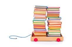 Böcker i leksakvagn Royaltyfri Foto