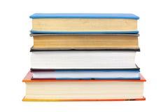 böcker isolerad seriebunt Arkivfoto