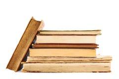 böcker isolerade den gammala bunten Arkivfoto