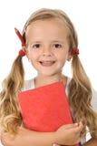 böcker little blyertspennaståendeschoolgirl Arkivfoto