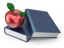 Böcker med den vård- läs- läroboken för röd äppleutbildning Arkivfoto