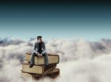 B?cker ovanf?r moln fotografering för bildbyråer