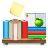Böcker på en trähylla Fotografering för Bildbyråer