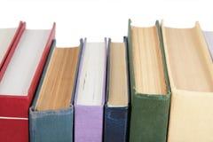 böcker stänger sig staplar upp royaltyfria foton
