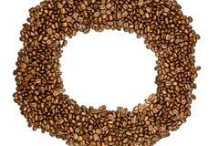 Bönor av kaffe som isoleras på vit bakgrund Royaltyfria Bilder
