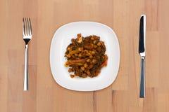 bönor braised morötter arkivfoto