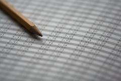 Börseenzahlen mit Bleistift Stockfotografie