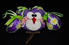 Búho de Pascua con los huevos Imagen de archivo