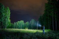 Búsqueda con la linterna en al aire libre Imágenes de archivo libres de regalías