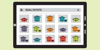 Búsqueda para Real Estate en una tableta Foto de archivo libre de regalías
