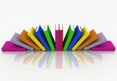 Bücher gelegen durch ein Gebläse Stockfotos