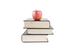 Bücher und Apfel Stockfotos