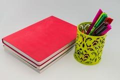 Bücher und Stift Stockbilder