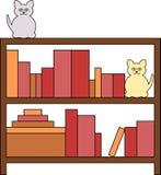 Bücherschrank mit Katzen Lizenzfreie Stockfotos