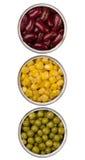 In Büchsen konservierte Bohnen, Erbsen und Mais in den Metalldosen Lizenzfreie Stockbilder