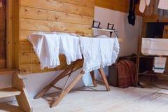 Bügelnde antike Unterwäsche Stockfotografie