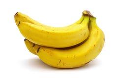 Bündel Bananen auf weißem Hintergrund Lizenzfreie Stockfotos