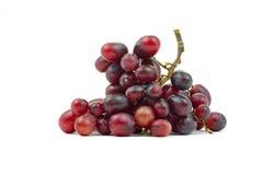 Bündel des kleinen Isolats der roten Trauben auf weißem Hintergrund Lizenzfreies Stockbild