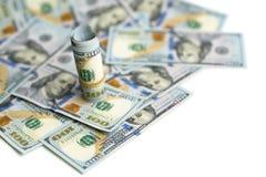 Bündel Dollar beim Rechnungsverschüttet.werden Lizenzfreie Stockfotos