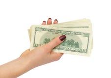 Bündel Dollar in der weiblichen Hand Lizenzfreie Stockfotos