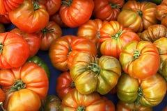 Bündel gemischte rote und gelbe Kirsche und italienische Tomaten auf BAC Lizenzfreies Stockbild