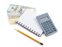 Bündel von Dollar, von Taschenrechner und von Notizbuch Lizenzfreie Stockfotos