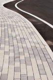 Bürgersteig- und Straßenkurve Lizenzfreie Stockbilder