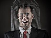 Büroangestellter ` s Kopf innerhalb eines Birdcage stockbild