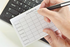 Büroarbeit mit dem Zeitplan Stockfoto