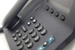 Bürotelefon im weißen Hintergrund Lizenzfreie Stockfotos