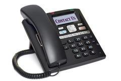 Bürotelefon Kontakt, den wir auf Weiß trennten Stockfoto