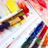 Bürsten und Aquarellfarben Lizenzfreie Stockbilder