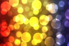 Bürsten- und Tapetenhintergrund rote gelbe blaue Mischungsfarbeglühender heller Bokeh Lizenzfreie Stockfotos