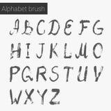 Bürstenskript Tintenalphabet Stockbilder
