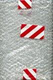 bąbla czerwonej taśmy biały opakunek Obrazy Stock