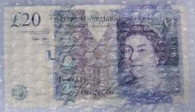 bąbla notatki funt dwadzieścia pod opakunkiem Zdjęcie Royalty Free