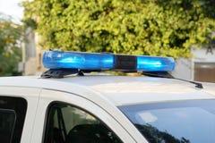 Błękitów światła na górze samochodu policyjnego Fotografia Stock
