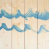 Błękit fala rysować nad drewnianymi deskami Obraz Royalty Free