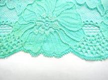 Błękit koronkowa tkanina na białym tle od above Fotografia Stock