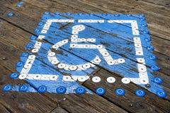 Błękit malujący miejsce do parkowania rezerwujący dla niepełnosprawnego Obraz Royalty Free