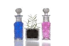 Błękit różowe krystaliczne szklane butelki Obraz Royalty Free