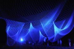 Błękit sieć na Glo nocy Zdjęcia Royalty Free