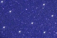 Błękit z gwiazdowym błyskotliwości bokeh abstrakta tłem Obrazy Royalty Free