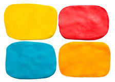 Błękita, czerwieni, koloru żółtego i pomarańcze plasteliny tekstura odizolowywająca na białym tle, Obraz Royalty Free
