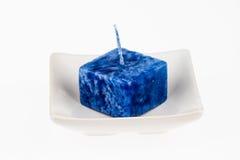 Błękitna świeczka na talerzu Zdjęcie Royalty Free