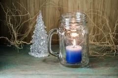 Błękitna świeczka w butelki szkle Fotografia Royalty Free