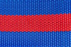 Błękitna & czerwień wyplatająca nicielnica zamknięta w górę jako obrazy stock