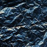 Błękitna dziurkowata szorstka powierzchnia z pęknięciami i złotymi włączeniami Obdarty kamień Być może obrazy stock