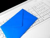 Błękitna koperta i biała klawiatura Obrazy Royalty Free