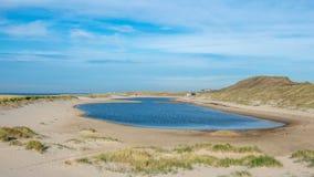 Błękitna laguna przy Camperduin, Schoorl holandie obrazy stock